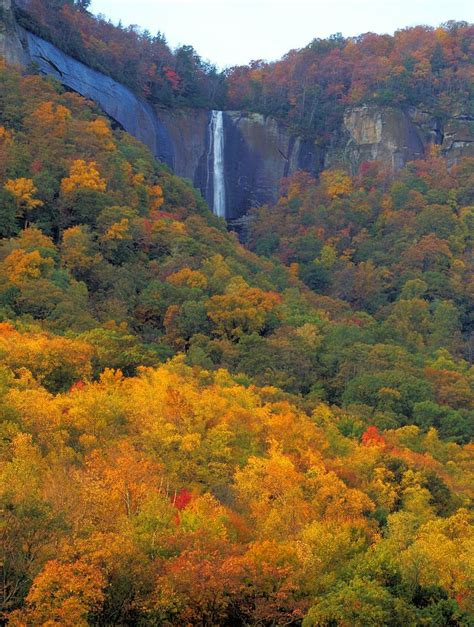 asheville fall colors hickory nut falls at chimney rock state park with peak