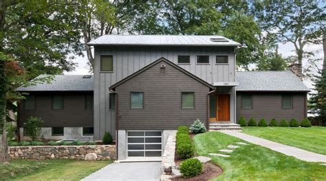 dark gray siding exterior craftsman with back deck back