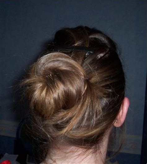 selena gomez wearing a elegant low bunchignon hairstyle awesome fashion 2012 awesome low bun hairstyle