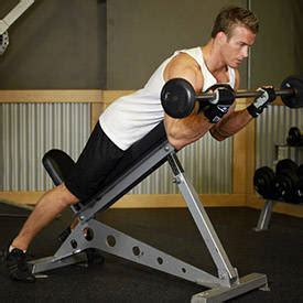 spider curl bench barbell curls lying against an incline exercise guide and