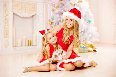 mother  daughter dressed  santa celebrate christmas family stock image image  female
