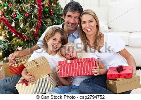 stock photo of happy family holding christmas gifts and