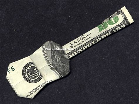 Origami Guitar Dollar Bill - money origami guitar made with 100 dollar bill by