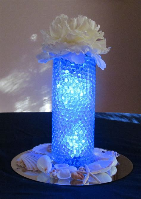 Sample Centerpiece   blue water beads, clear light inside