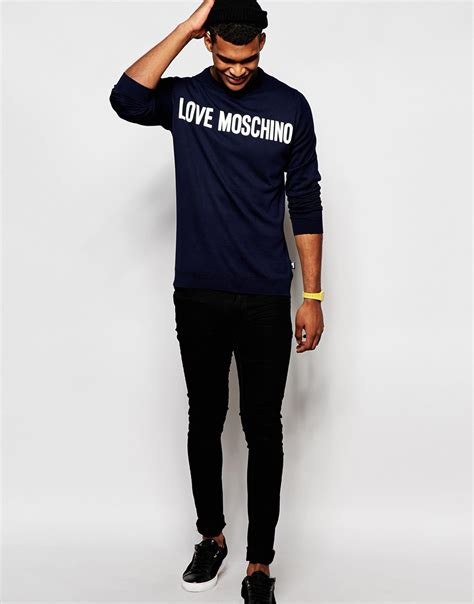 Jumper Moschino moschino jumper with script logo in blue for lyst