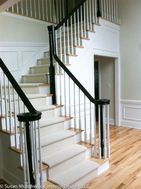 traditional entryway with painted banister and new carpet
