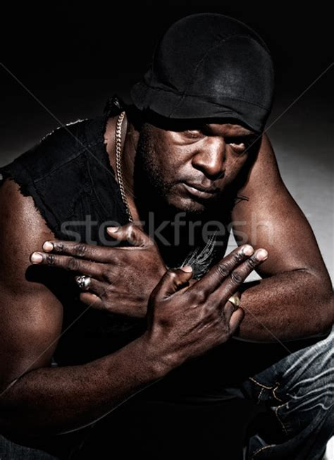 Black Gangster black gangster ready to fight on background stock
