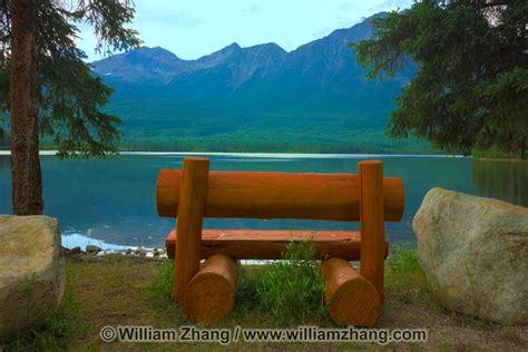 benching pyramid bench on spirit island at pyramid lake in jasper national park