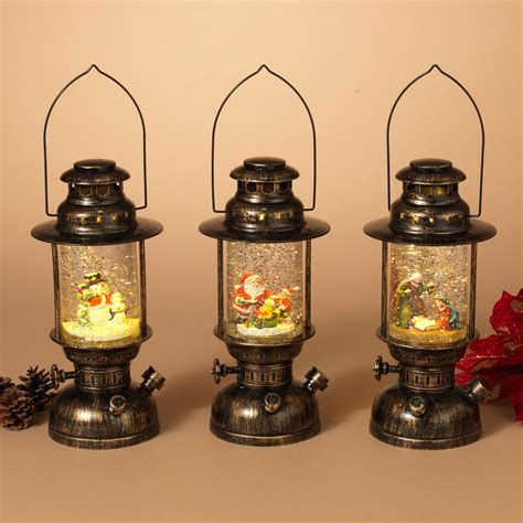 christmas central home decor gerson 10 in battery operated spinning water globe lanterns with holiday scene set of 3
