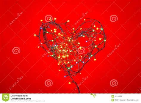heart shaped christmas lights heart shaped christmas lights on red stock image image