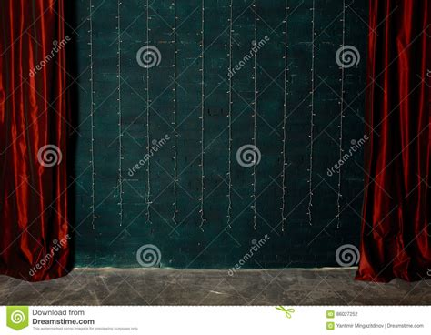 red wall curtains red curtains on brick wall background stock photo image