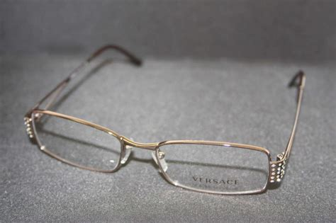 versace light brown w rhinestones s frames