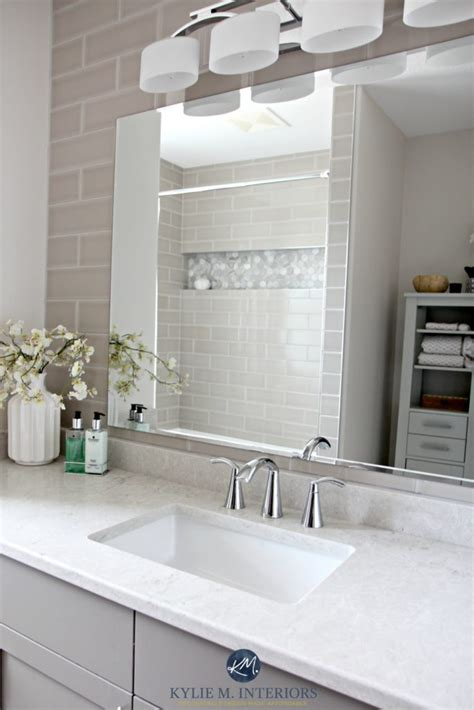 bathroom with subway tile wall behind vanity bianco drift