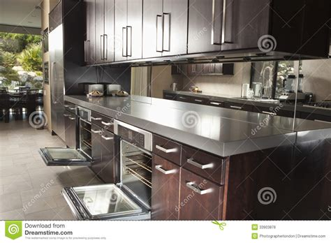 Dark Wood Cabinets Kitchen Commercial Kitchen With Open Oven And Cabinets Stock Photo