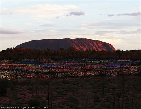 bruce munro field of light ayers rock artwork made from lights transforming the