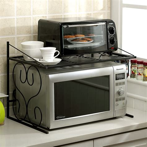 Black wrought iron microwave wall shelf in the corner small spaces kitchen ideas