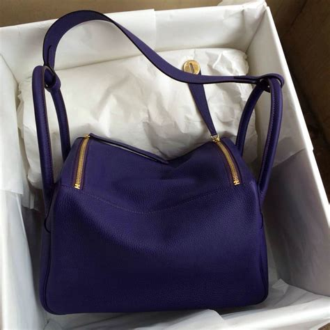 Hermes Lindy Togo stitching hermes lindy bag 9k iris purple togo leather gold hardware hermes