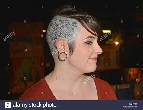 shaved head tattoo portrait of a with a partially and