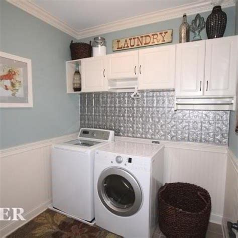shorter cabinet with hanging rod laundry room
