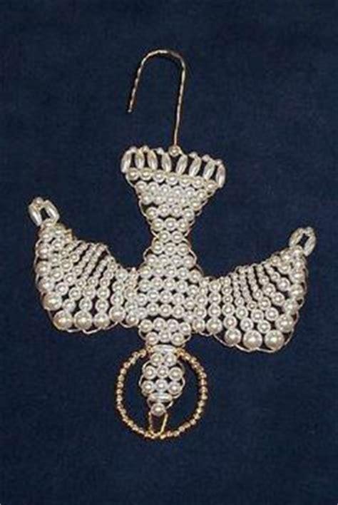 chrismon ornaments on beaded cross