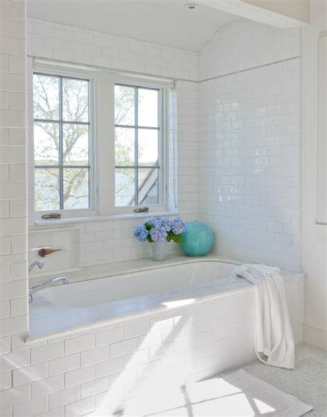 white house bathtub subway tile shower surround transitional bathroom
