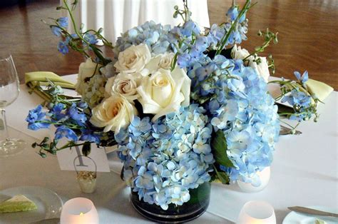 blue hydrangea flower arrangements blue and gold floral arrangements blue wedding