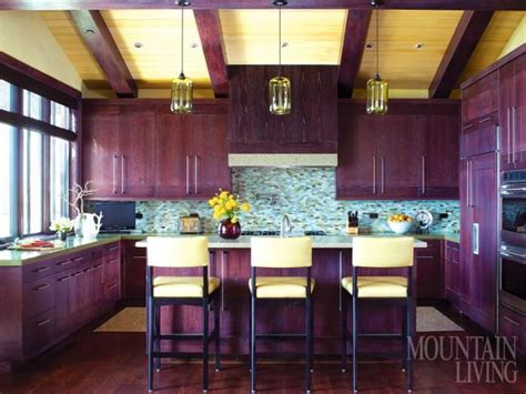 the kitchen cabinets are white oak with an aubergine