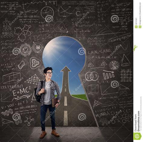 doors into the future student standing in front a future door stock image