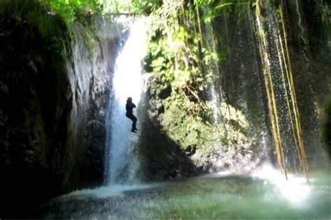 canyoning gitgit waterfall bali indonesia