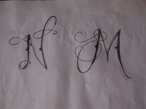 m m tattoo designs lettering n and m by nicky8 on deviantart