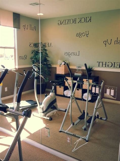 workout room mirrors workout room with mirrors on one wall and workout words on the others just add a t v and you re