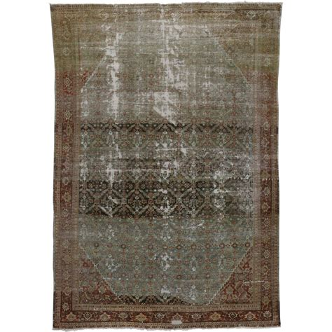 industrial style rugs distressed antique mahal rug with modern industrial style for sale at 1stdibs