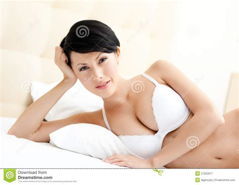adults in bed woman in underwear is lying in the double bed stock image