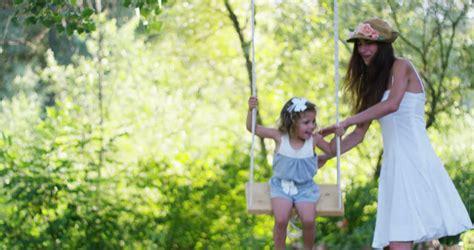 swinging mums cute little girl on a swing stock footage video 12740687