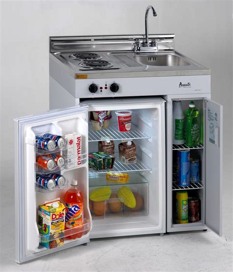 compact kitchen with stove refrigerator and sink
