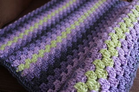 wave afghan in green and purple crochet throw blanket lori s purple and green granny stripe from ravelry