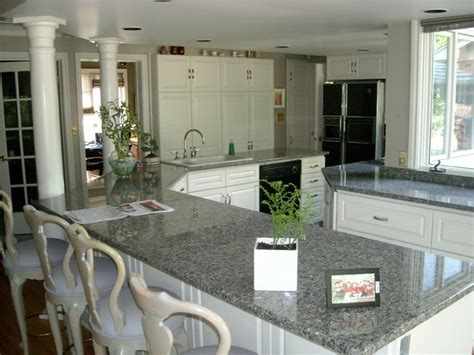 New Caledonia Granite White Cabinets by Granite Kitchens Traditional Kitchen Other Metro