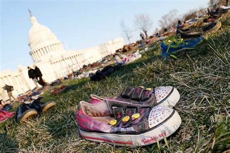 kid killed for shoes 7 000 pairs of shoes laid out in washington d c to