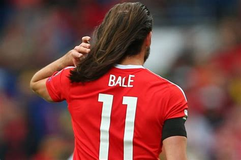 gareth bale long hair gareth bale s hair falls out of his man bun during wales