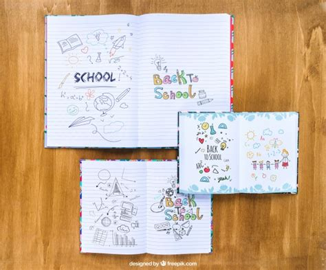 notebooks with drawings on wooden table psd file free