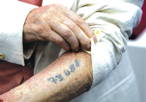 holocaust tattoo history hushed silence opinion jerusalem post