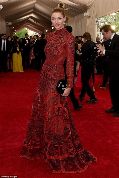 the met gala themes and fashion through the years jessica hart is ravishing in red chinoiserie style velvet gown at met gala 2015 daily mail online