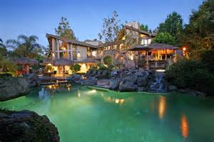 luxury estate with stunning rock lagoon pool in anaheim exotic homes things i like pinterest examples