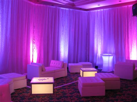 party draping gray pipe drape with purple uplighting on 3 walls ken