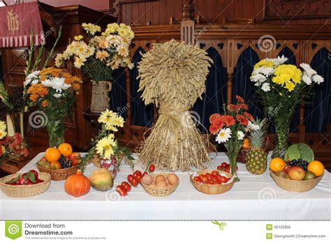 festive decoration services harvest festival display with sheaf of corn stock photo
