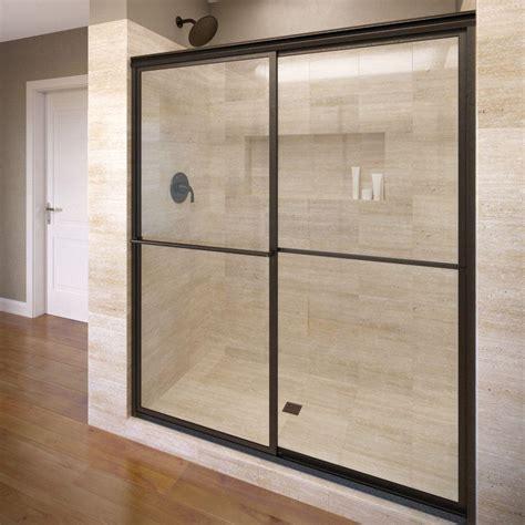 Basco Sliding Shower Doors Basco Classic 44 In X 65 1 2 In Semi Framed Sliding Shower Door In Rubbed Bronze 3500