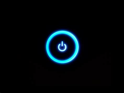 black wallpaper with the power blue xbox power button glow xbox 360 black background