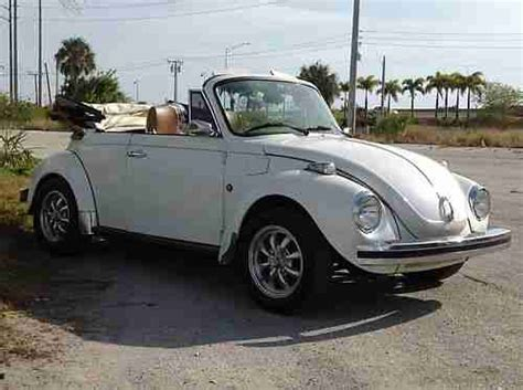find   volkswagen beetle convertible  rust  pearl white paint  reserve