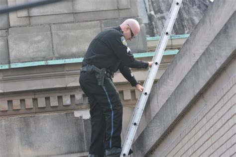 Alton Post Office by Two Taken Safely After Being Discovered On Rooftop Of