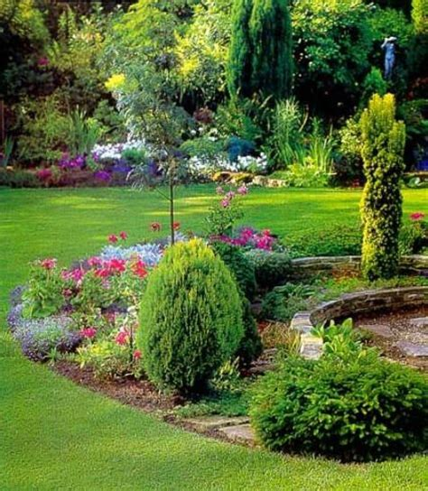 evergreen shrubs and perennial flowers framed by a lush lawn in birmingham al we require